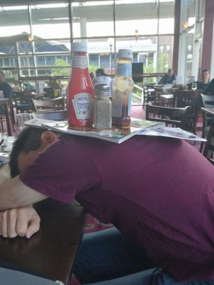 Milton Keynes 2017 - Graeme being used as a table the morning after